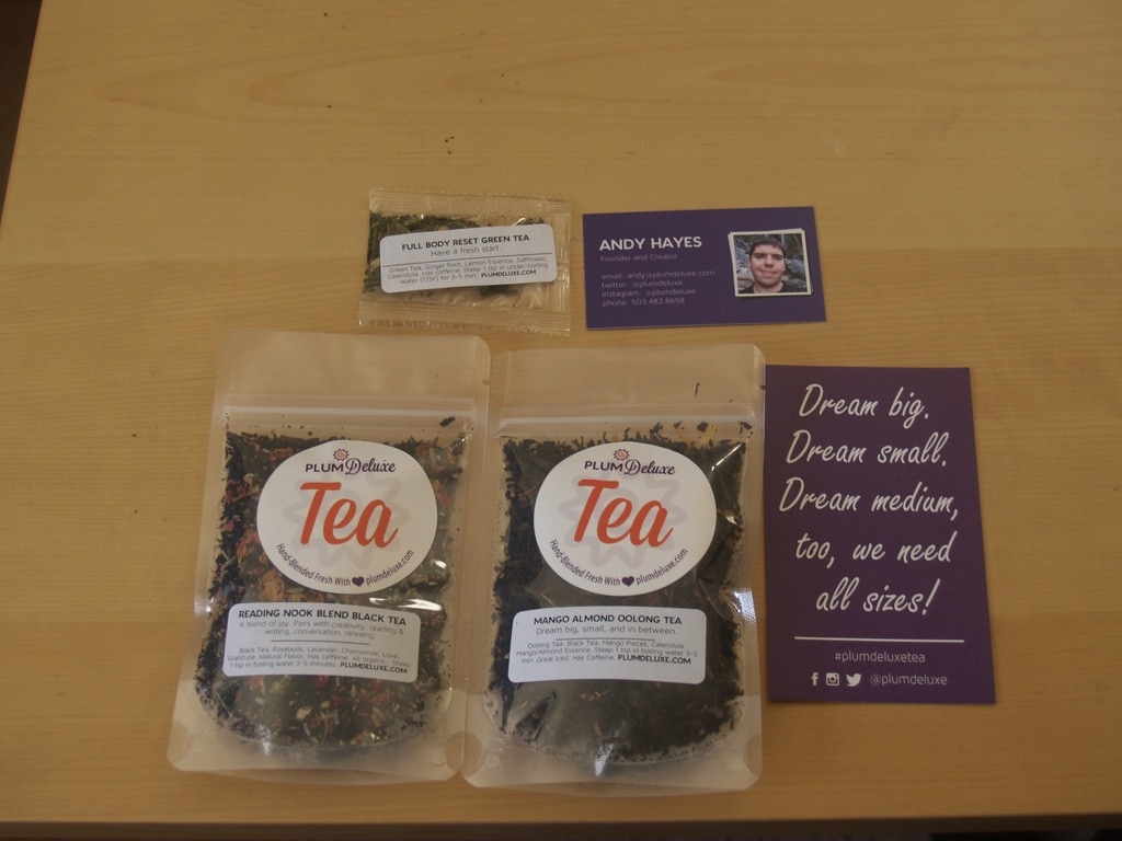 """Two packs of tea, one small sample pack, a calling card and a larger motivation card with the text """"Dream big, dream small, dream medium, we need all sizes"""""""