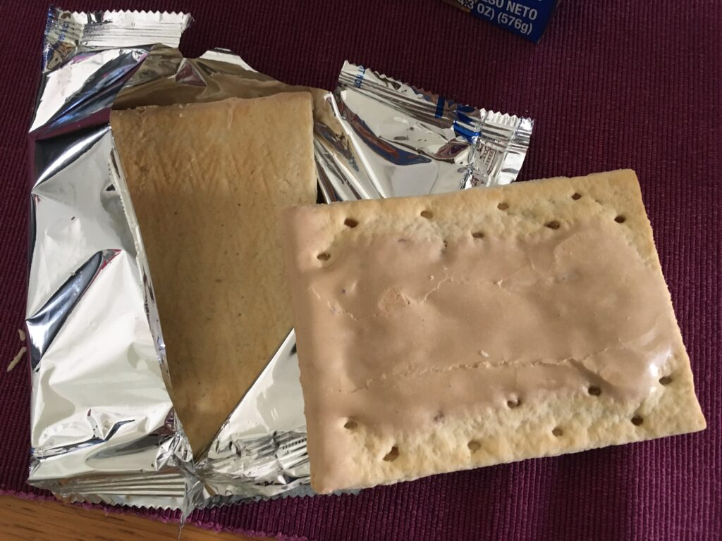 Foil with two brown sugar cinnamon poptarts revealed.